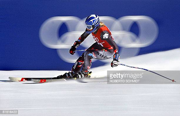 Swiss Marlies Oester races into the finish area after the women's downhill 2nd training for the 2002 Salt Lake City Olympic Winter Games in Snowbasin...