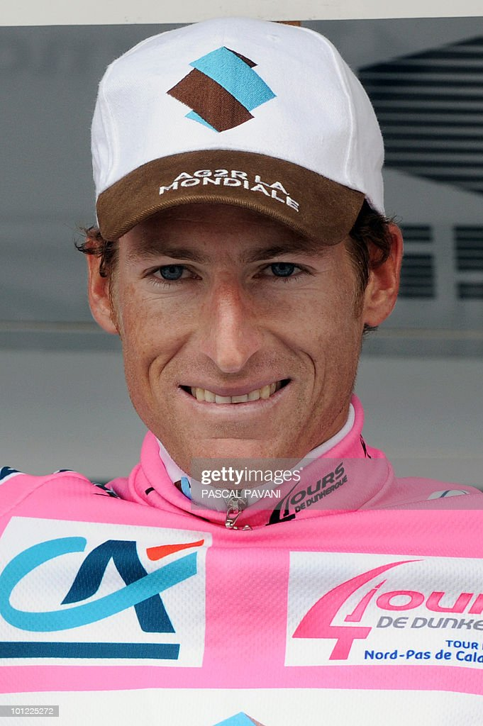 Swiss Martin Elmiger celebrates his pink jersey of the overrall leader on the podium at the end of the fourth stage of the Four Days of Dunkirk cycling stage on May 8, 2010 in Cassel, northern France.