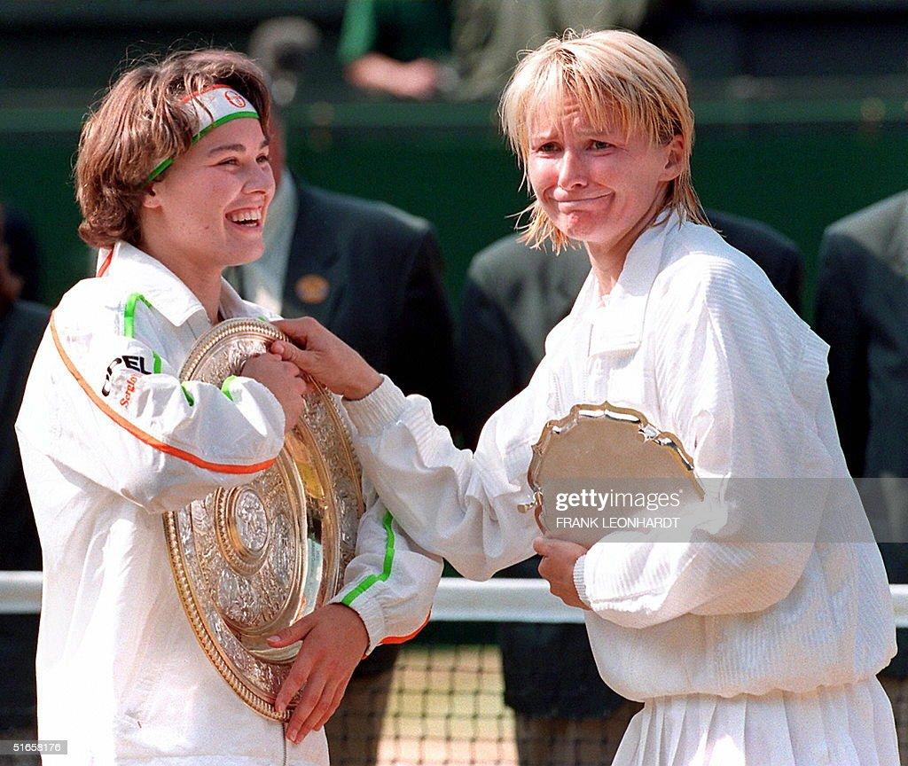 Swiss Martina Hingis (L) holds on to the winner's : News Photo