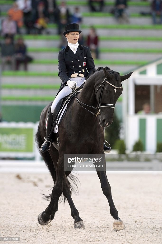Swiss Melano Hofmann rides GB Cazzago C on August 26, 2014 during the second session of the Dressage Grand Prix of the 2014 FEI World Equestrian Games at D'Ornano Stadium in the northwestern French city of Caen. TRIBALLEAU