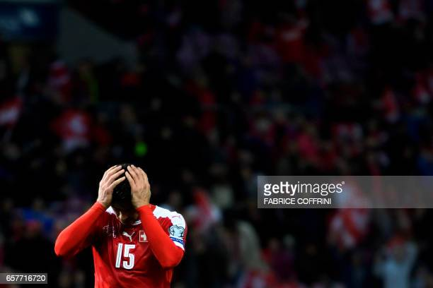 Swiss midfielder Blerim Dzemaili reacts after missing an action during the FIFA World Cup 2018 qualifying football match between Switzerland and...