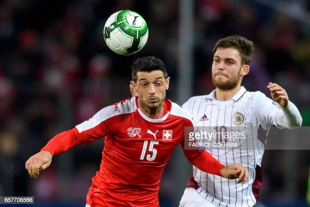 Swiss midfielder Blerim Dzemaili vies with Latvian forward Valerijs Sabala during the WC 2018 qualifying football match Switzerland vs Latvia on...