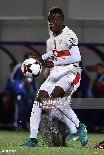 Swiss midfielder Denis Zakaria runs with the ball during the FIFA World Cup 2018 football qualifier between Andorra and Switzerland at the Municipal...