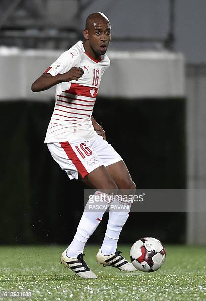 Swiss midfielder Gelson Fernandes eyes the ball during the FIFA World Cup 2018 football qualifier between Andorra and Switzerland at the Municipal...