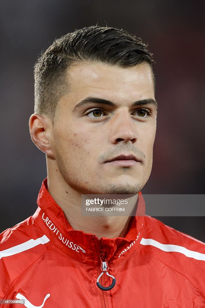 Swiss midfielder Granit Xhaka stands during the national anthem prior to the Euro 2016 qualifying football match between Switzerland and Slovenia at the St. Jakob Park Stadium in Basel on September 5, 2015. Switzerland defeated Slovenia 3-2.