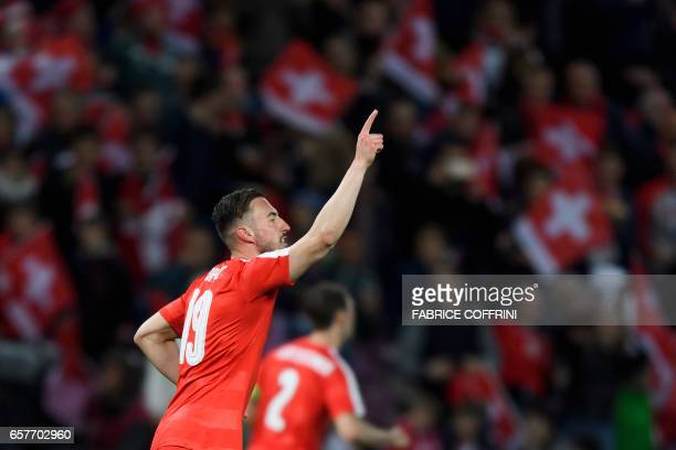 Swiss midfielder Josip Drmic celebrates his goal during the WC 2018 qualifying football match Switzerland vs Latvia on March 25 2017 at the Stade de...