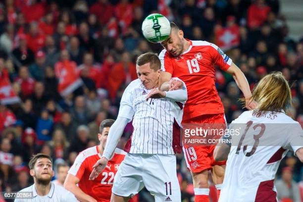 Swiss midfielder Josip Drmic scores the first goal during the WC 2018 qualifying football match Switzerland vs Latvia on March 25 2017 at the Stade...