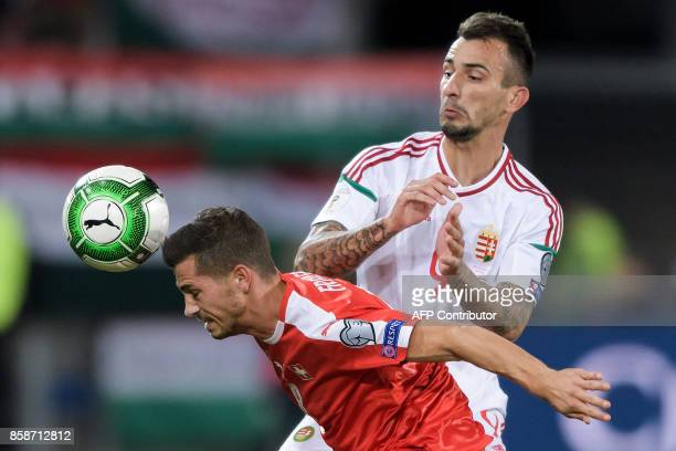 Swiss midfielder Remo Freuler and Hungarian forward Roland Ugrai vie for the ball during the FIFA World Cup WC 2018 football qualifier match between...