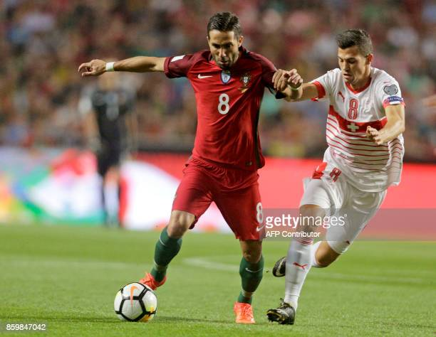 Swiss midfielder Remo Freuler and Portugals midfielder Joao Moutinho vie for the ball during the FIFA World Cup 2018 Group B qualifier football match...