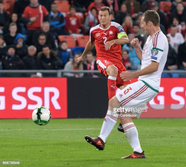 Swiss midfielder Stephan Lichtsteiner scores a goal during the FIFA World Cup WC 2018 football qualifier match between Switzerland and Hungary at the...