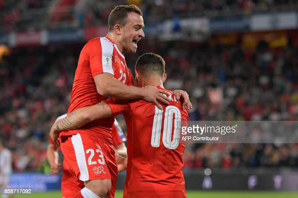 Swiss midfielder Xherdan Shaqiri and Swiss midfielder Granit Xhaka celebrate a goal during the FIFA World Cup WC 2018 football qualifier match...