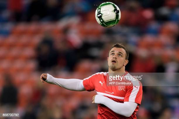 Swiss midfielder Xherdan Shaqiri controls the ball during a warm up sesison prior to the the FIFA World Cup WC 2018 football qualifier match between...