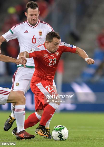 Swiss midfielder Xherdan Shaqiri drives the ball during the FIFA World Cup WC 2018 football qualifier match between Switzerland and Hungary at the St...
