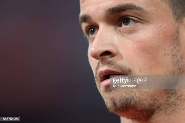 Swiss midfielder Xherdan Shaqiri looks on during a warm up sesison prior to the the FIFA World Cup WC 2018 football qualifier match between...