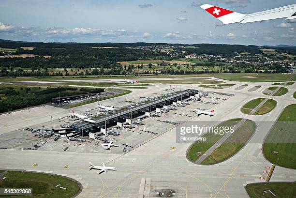 A Swiss national flag sits on the wingtip of a Bombardier Inc CS 100 C Series jet operated by Swiss International Air Lines AG as Zurich Airport...