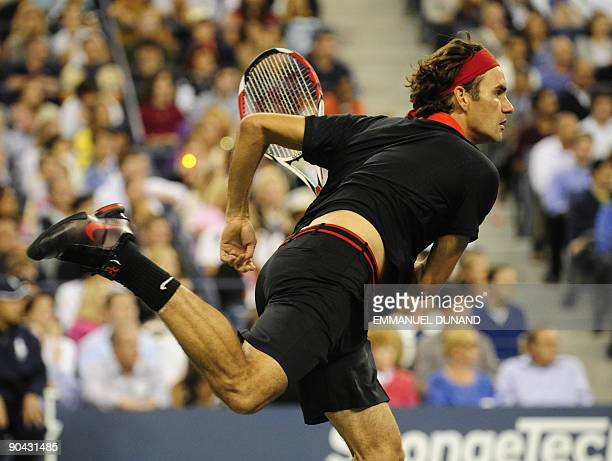 Swiss number one seed player Roger Federer serves a shot to Germany's Simon Greul during their second round match during day three of the 2009 US...