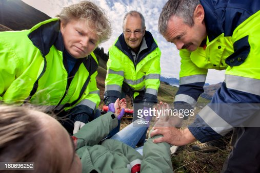 Swiss Paramedics Care For Injured Young Woman in Alps
