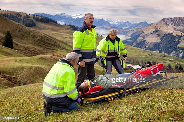 Swiss Paramedics Team Care For Injured Woman in Alps