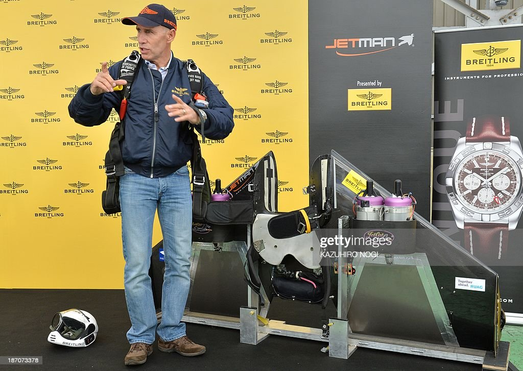 Swiss pilot Yves Rossy, or 'Jetman', introduces his 60 kg (132 pound) flight equipment, including the wings which strap onto his back, at a press conference in Tokyo on November 6, 2013. Swiss aviator Yves 'Jetman' Rossy, whose jet-engine powered wings have taken him over some of the world's most awe-inspiring places, has added another, Japan's Mount Fuji.