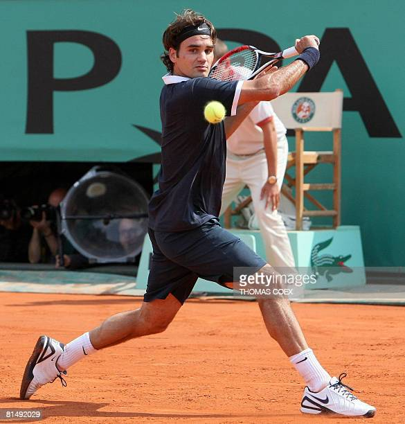 Swiss player Roger Federer hits a return to Spanish player Rafael Nadal during their French tennis Open final match at Roland Garros on June 08 2008...
