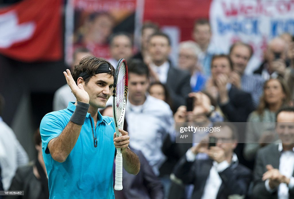 Swiss player Roger Federer waves after his match against Grega Zemlja from Slovakija in the first round of the ABN Amro ATP Tennis tournament in Rotterdam on February 13, 2013. Federer won the match in two sets 6-3 6-1. ANP KOEN SUYK netherlands out AFP PHOTO / ANP / KOEN SUYK netherlands out