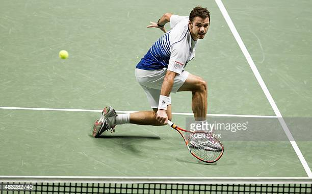 Swiss player Stanislas Wawrinka returns the ball to Spanish player Guillermo GarciaLopez during their tennis match at the ABN AMRO World Tennis...