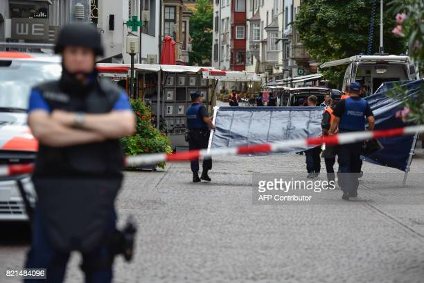 Swiss police arrive to set up a barrier at a crime scene in the old quarter of Schaffhausen northern Switzerland on July 24 after a man armed with a...