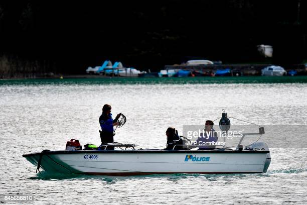 Swiss police on a boat scour the Aiguebelette lake on September 11 2017 in AiguebeletteleLac eastern France as part of the search operations to find...