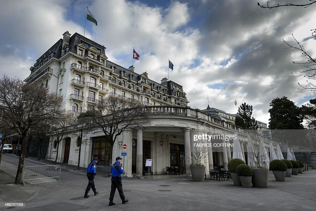 Swiss police secure the area around the BeauRivage Palace hotel during Iran nuclear talks in Lausanne Switzerland on April 1 2015 Russia and Iran...