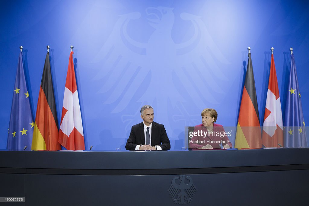 Swiss President <a gi-track='captionPersonalityLinkClicked' href=/galleries/search?phrase=Didier+Burkhalter&family=editorial&specificpeople=6269147 ng-click='$event.stopPropagation()'>Didier Burkhalter</a> speaks with German Chancellor <a gi-track='captionPersonalityLinkClicked' href=/galleries/search?phrase=Angela+Merkel&family=editorial&specificpeople=202161 ng-click='$event.stopPropagation()'>Angela Merkel</a> to the media after talks at the Chancellery on February 18, 2014 in Berlin, Germany. Burkhalter is visiting several EU member state capitals following the recent referendum that will limit immigration to Switzerland, a move that has caused an uproar across the EU and could require the renegotiation of a variety of treaties with Switzerland.