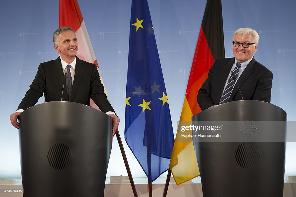 Swiss President <a gi-track='captionPersonalityLinkClicked' href=/galleries/search?phrase=Didier+Burkhalter&family=editorial&specificpeople=6269147 ng-click='$event.stopPropagation()'>Didier Burkhalter</a> (L) speaks with German Foreign Minister <a gi-track='captionPersonalityLinkClicked' href=/galleries/search?phrase=Frank-Walter+Steinmeier&family=editorial&specificpeople=603500 ng-click='$event.stopPropagation()'>Frank-Walter Steinmeier</a> (R) to the media after talks at the Foreign Ministry on February 18, 2014 in Berlin, Germany. Burkhalter is visiting several EU member state capitals following the recent referendum that will limit immigration to Switzerland, a move that has caused an uproar across the EU and could require the renegotiation of a variety of treaties with Switzerland.
