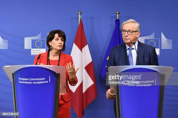 Swiss President Doris Leuthard and European Commission President JeanClaude Juncker address a press conference after their meeting at the European...