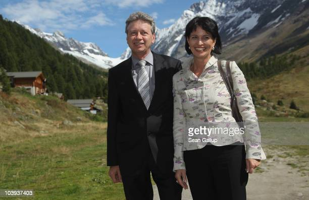 Swiss President Doris Leuthard and her husband Roland Hausin pose for a picture in the Swiss Alps after arriving by helicopter for lunch with German...
