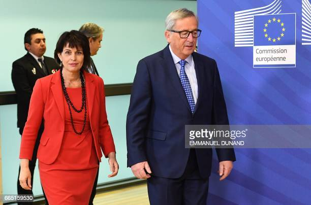Swiss President Doris Leuthard arrive with European Commission President JeanClaude Juncker at the European Commission in Brussels on April 6 2017 /...