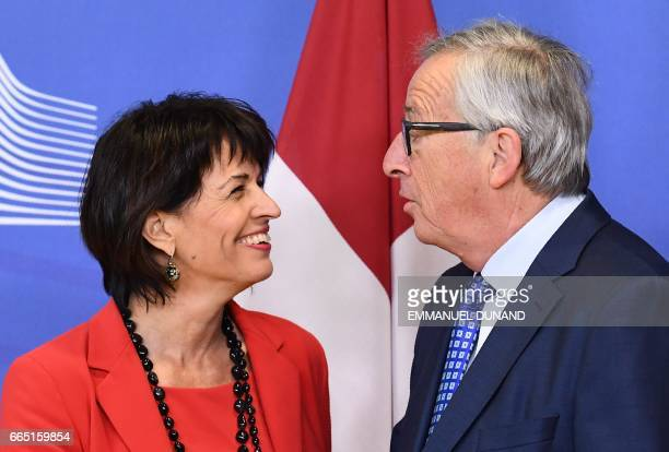Swiss President Doris Leuthard is welcomed by European Commission President JeanClaude Juncker at the European Commission in Brussels on April 6 2017...