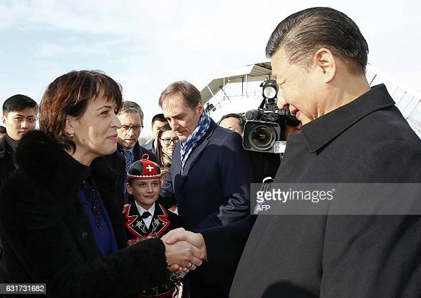 Swiss President Doris Leuthard shakes hands with Chinese President Xi Jinping during a welcome ceremony upon his arrival for a state visit to...