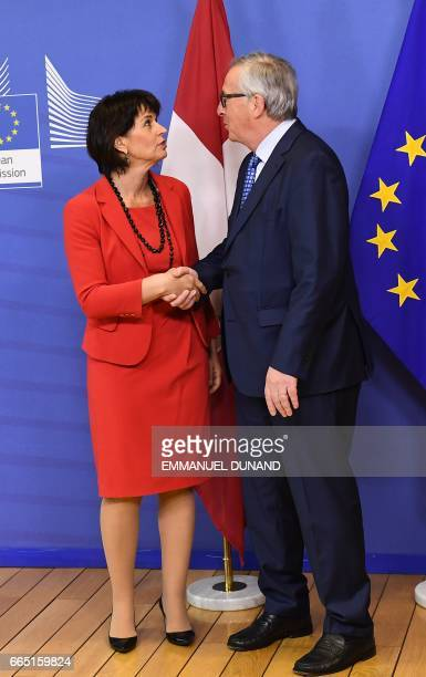 Swiss President Doris Leuthard shakes hands with European Commission President JeanClaude Juncker at the European Commission in Brussels on April 6...