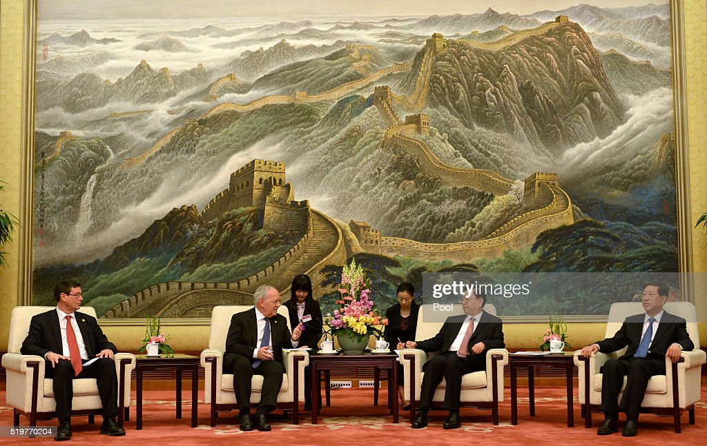 Swiss President Johann Schneider Amman talks with China's National People's Congress Chairman Zhang Dejiang during their meeting at the Great Hall of...