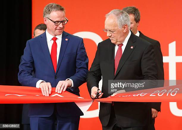 Swiss President Johann SchneiderAmmann cuts the ribbon next to Swiss Federal Railways CEO Andreas Meyer during the opening ceremony of the Gotthard...