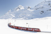 Swiss train with mountain in background