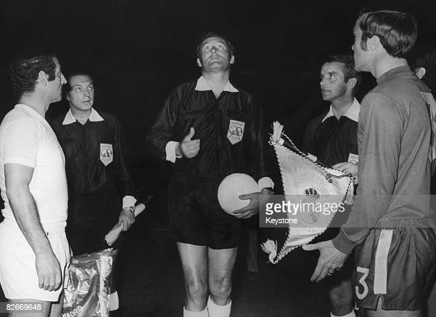 Swiss referee Rudolf Scheurer flips the coin before the UEFA Cup Winners' Cup final between Chelsea and Real Madrid at the Karaiskakis Stadium...