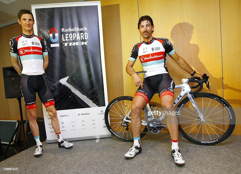 Swiss rider Fabian Cancellara (R) and Luxembourger rider Frank Schleck pose during the presentation of his team, Radioshack Leopard Trek in Alfaz del Pi, near southeastern Spanish city Alicante on January 18, 2013.