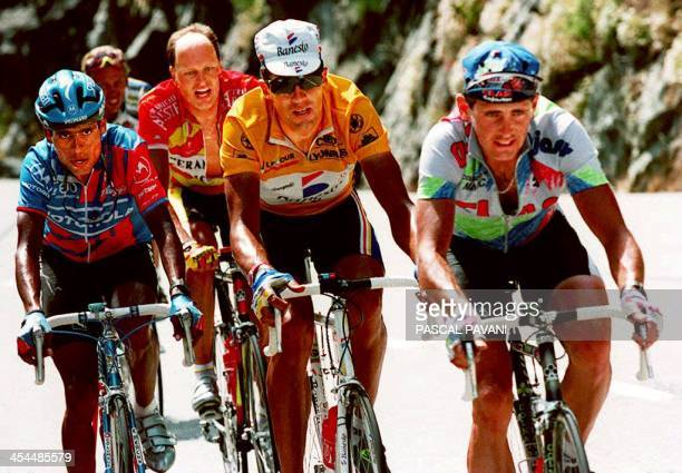 Swiss rider Tony Rominger Spaniard Miguel Indurain Danish Bjarne Riis and Columbian Alvar Mejia race ahead of the pack in the highest climb of the...