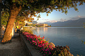 HDR landscape at golden hour time along the Quai Edouard Jaccoud in Montreux, on the shores of Lake Geneva, Switzerland.