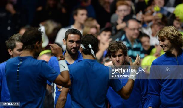 Swiss Roger Federer and Spanish Rafael Nadal both of Team Europe celebrate with their team mates Marin Cilic Dominic Thiem and Alexander Zverev after...