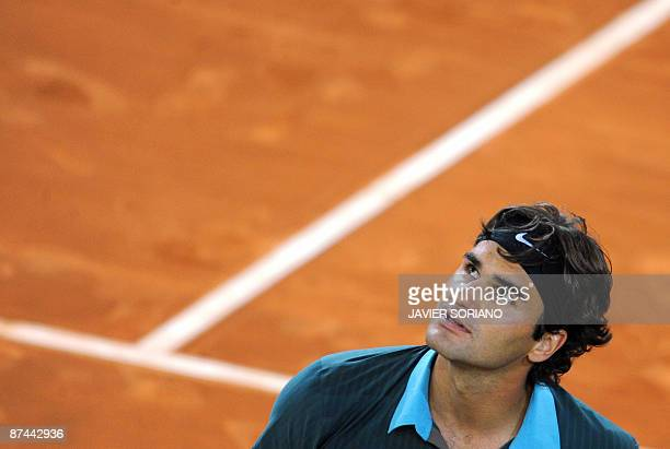 Swiss Roger Federer celebrates winning against Argentinian Juan Martin del Potro after their semi final match of the ATP Madrid Open claycourt...