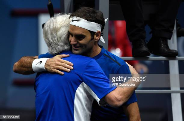 Swiss Roger Federer of Team Europe celebrates with Swedish Bjorn Borg captain of Team Europe after defeating US Sam Querrey of Team World during...