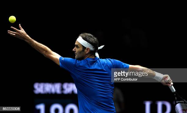 Swiss Roger Federer of Team Europe serves to US Sam Querrey of Team World during second day of Laver Cup on September 23 2017 in O2 Arena in Prague /...