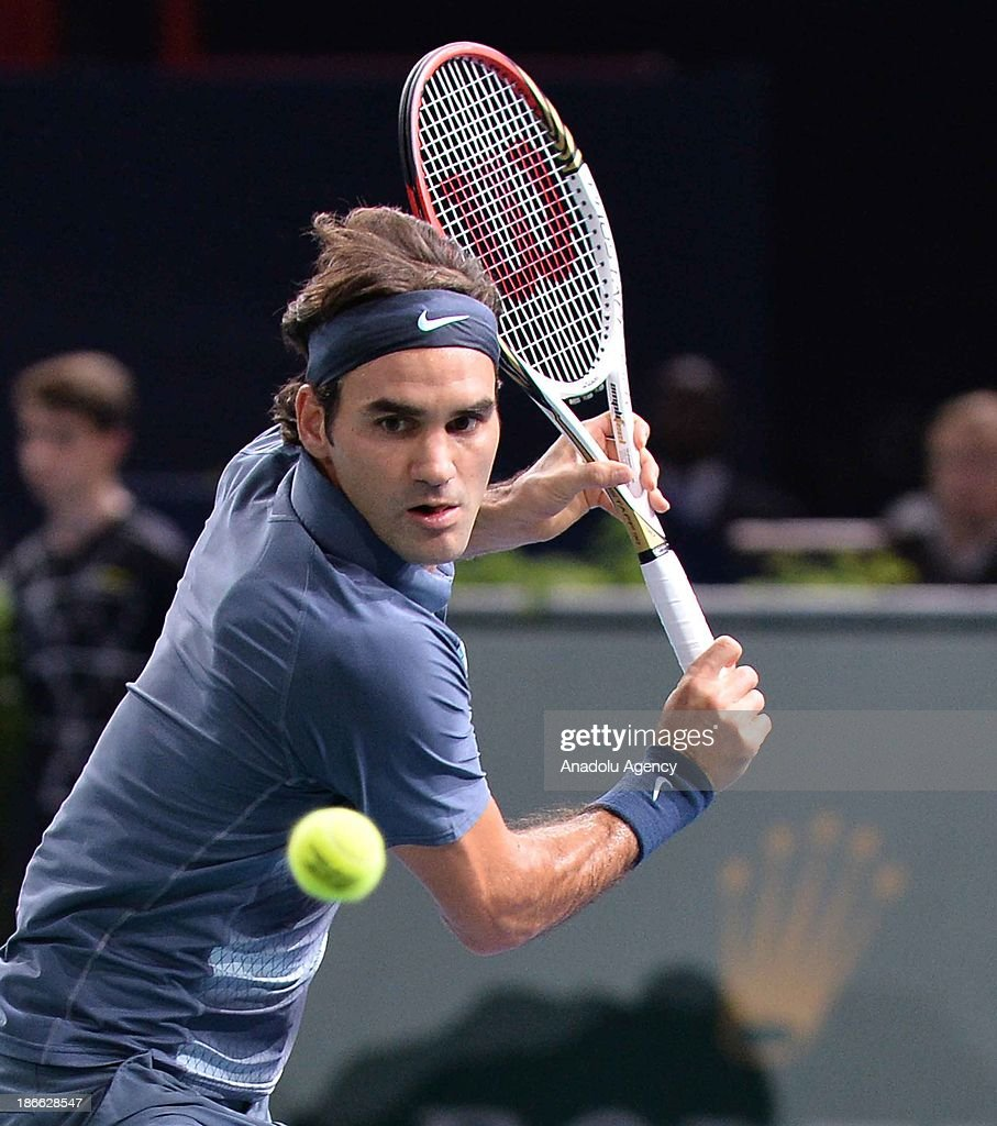 Swiss Roger Federer returns the ball to Serbian Novak Djokovic during the men's single semi final match at the BNP Paris Masters tennis tournament at Bercy Arena on November 2, 2013 in Paris, France.