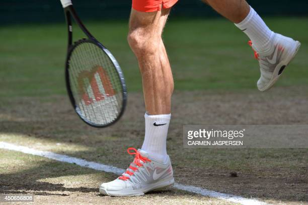 Swiss Roger Federer serves the ball during his final match against Alejandro Falla from Columbia at the ATP Gerry Weber Open tennis tournament in...